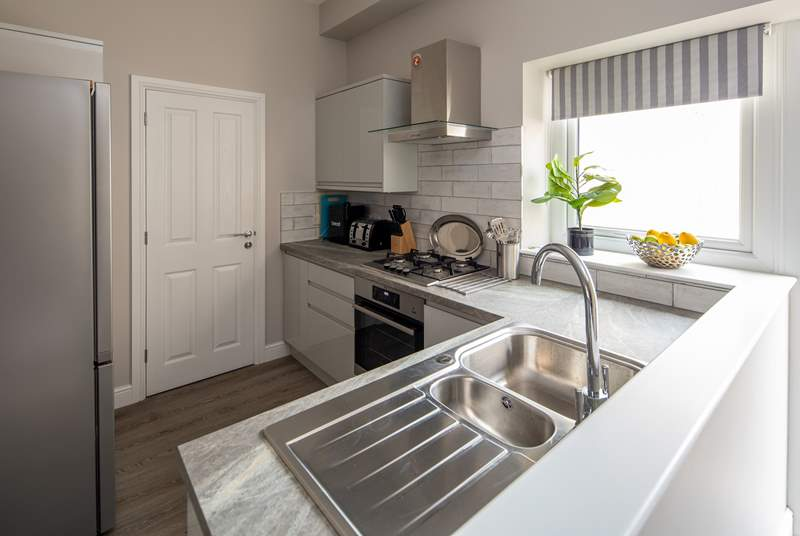 The kitchen is light, airy, and fully equipped for whipping up a feast.