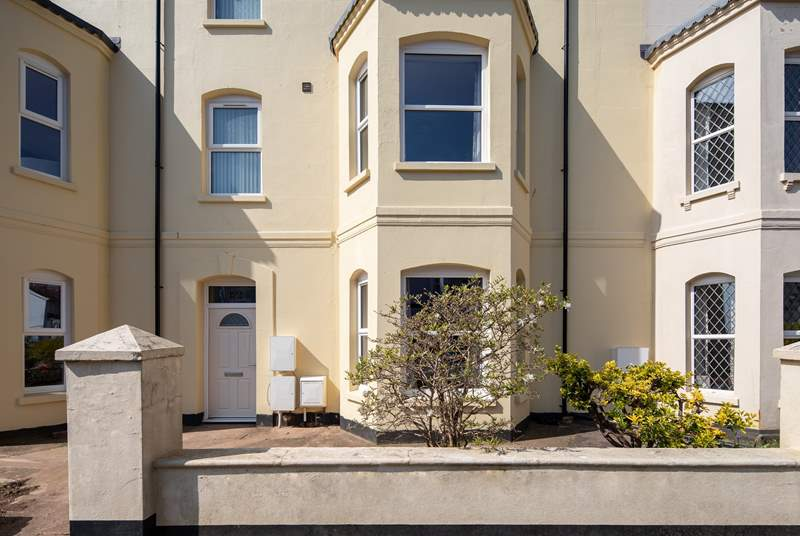 Magnolia is a proud terraced townhouse situated moments from the beach.
