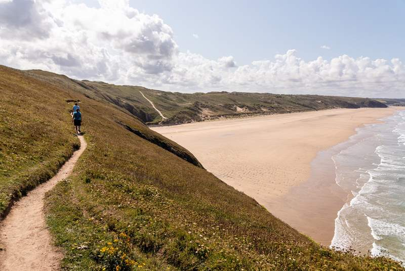 Clifftop walks, surfing lessons and sand dunes teeming with wildlife are all within walking distance, and much of the surrounding land is managed by the National Trust with well-maintained footpaths and nature reserves to explore.