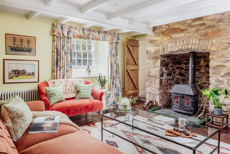 On winter days the sitting-room, complete with the original wood-burner, will be the heart of the home.