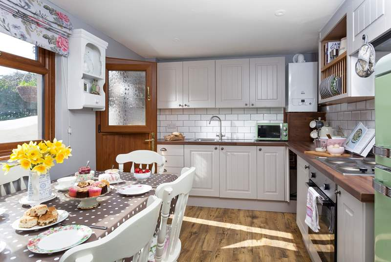 The bright kitchen/diner is a laid-back space for entertaining.