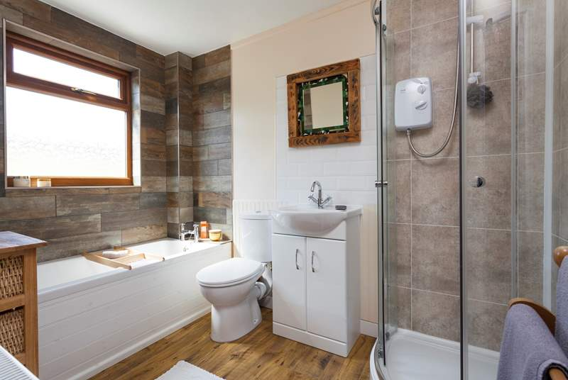 The contemporary family bathroom is also located on the first floor.