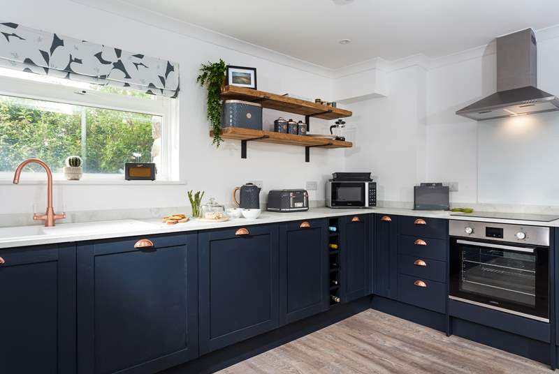 The gorgeous kitchen is very well-equipped.