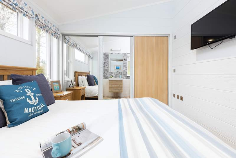 The main bedroom has a wonderful en suite shower, which is hidden behind the wardrobe doors.