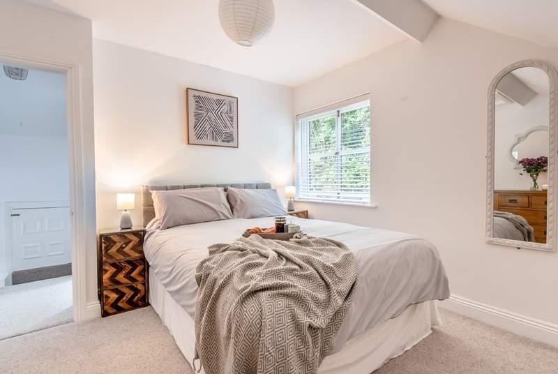 Elegant bedroom 1 has a super comfy king-size bed.