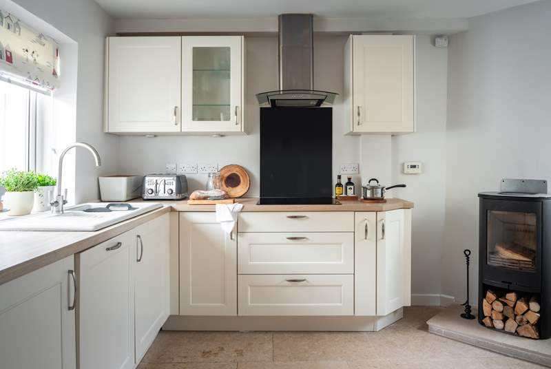 The fully equipped kitchen with the perfectly placed wood-burner.