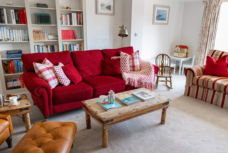 The formal sitting-room enjoys a log-burner and patio doors that lead out on to the garden.