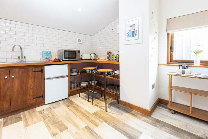 The compact kitchen area has everything you will need.