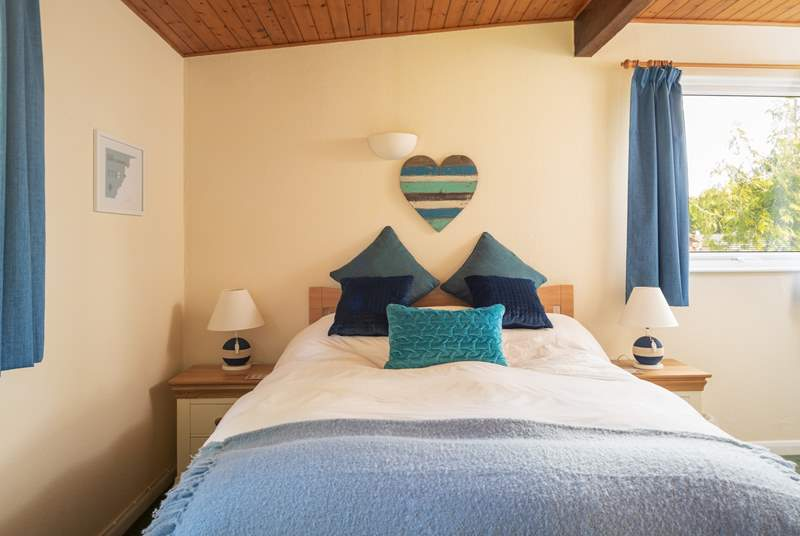 The main bedroom enjoys views and an en suite shower.