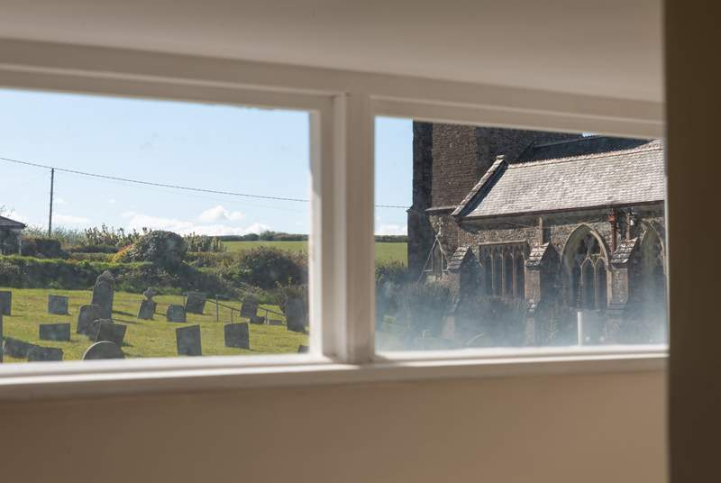 The view from the landing window across to the village church.