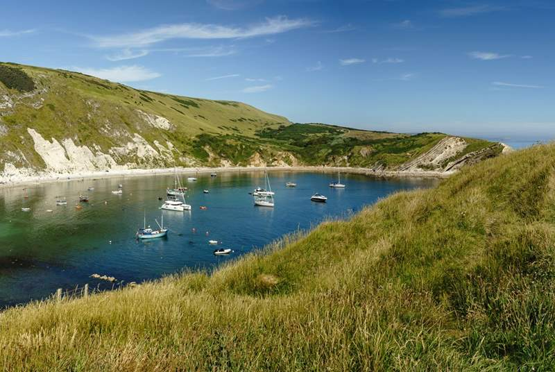 Lulworth Cove is simply spectacular and within walking distance of this pretty cottage.