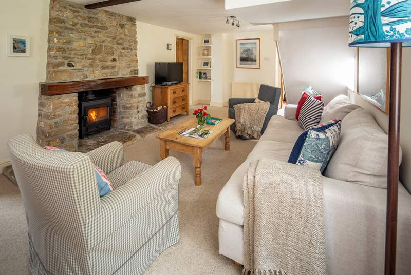 Cosy up in front of the fire.