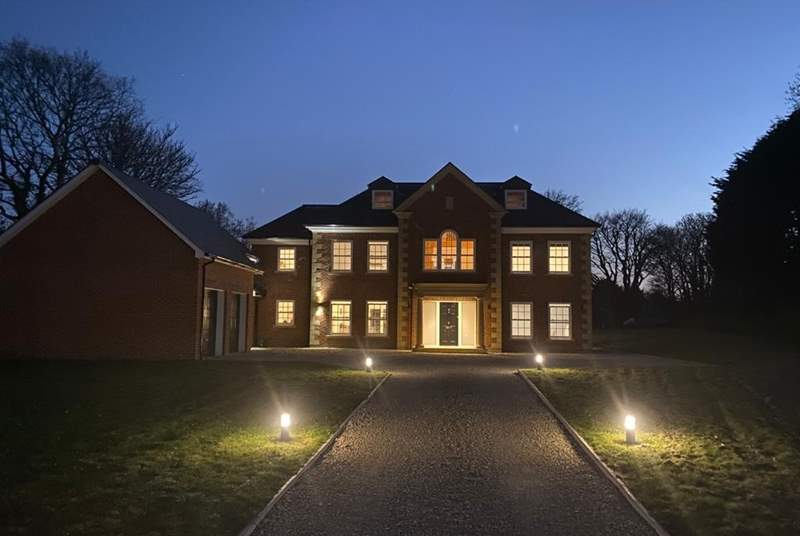 Impressive Willow House looks fabulous at night.