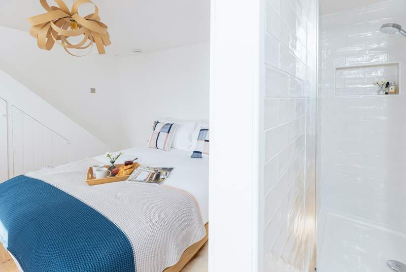 The bedroom on the ground floor has a compact en suite shower-room.