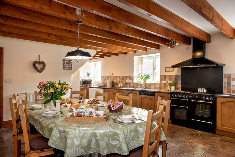 The spacious farmhouse-style kitchen/dining-room.