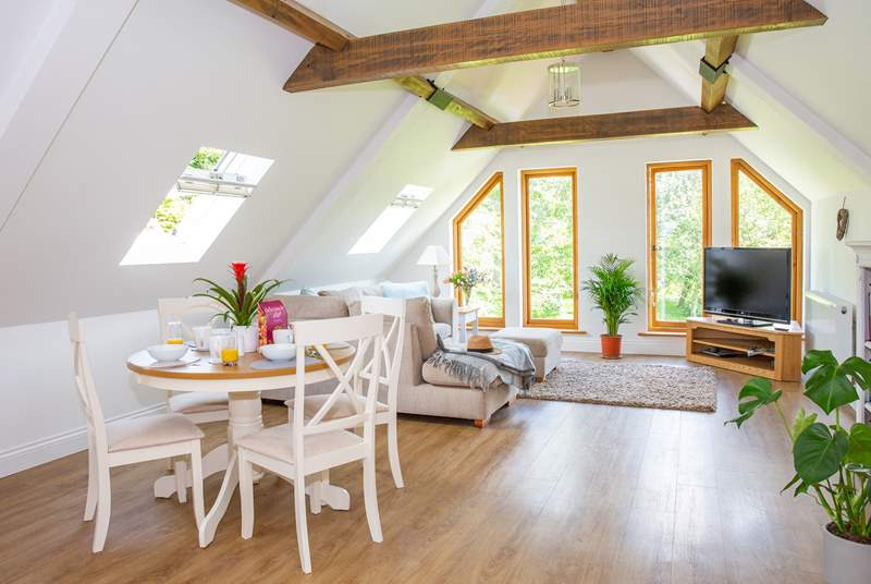 The open plan living area enjoys amazing views of the garden and surrounding woodland.