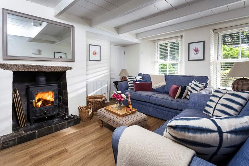 The sitting-room is a wonderfully cosy hideaway with two comfortable sofas perfect for sinking into at the end of the day.