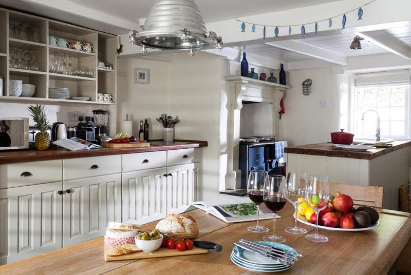 The gorgeous kitchen with its beamed ceilings and a fabulous dining space.