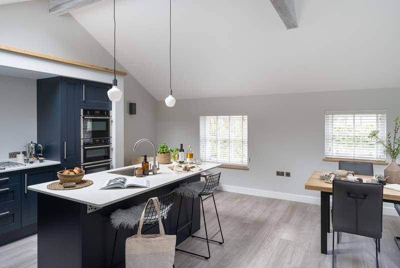 The light and spacious kitchen makes for a delightful place to cook up a feast.