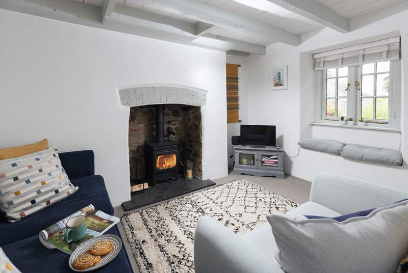 The wood-burner in the comfy sitting-room will keep you toasty during cooler months.