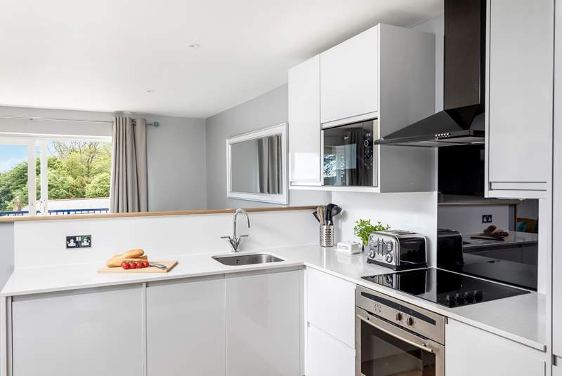 The swish kitchen in the open plan living-room.