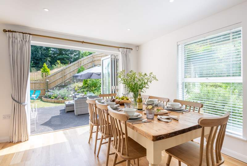 Open up the bi-fold doors in the kitchen/dining-room on to the garden.
