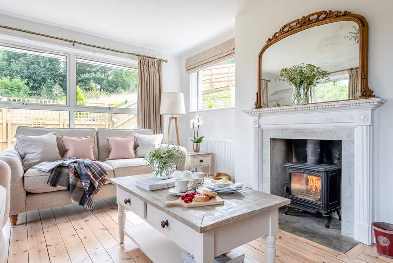 Light the wood-burner on those cooler days and get cosy in the sitting-room.