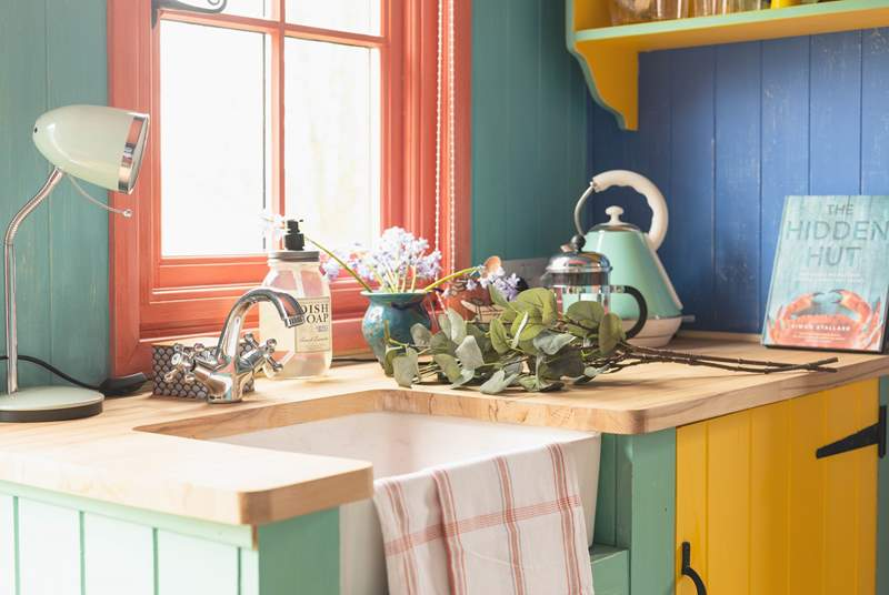 The colourful kitchen area has everything you need.