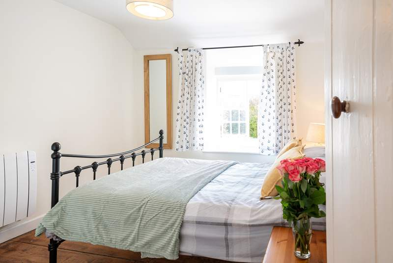 The lovely main bedroom on the first floor overlooks the front of the property.