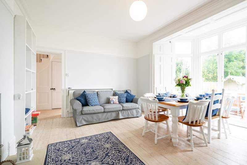 The spacious dining-room on the ground floor has lovely views across the garden.
