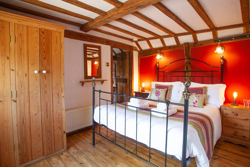 The beautiful ground floor bedroom is so warm and inviting.