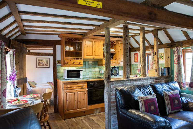 The open plan living area is cosy with lots of gorgeous beams, some low so please mind your head.