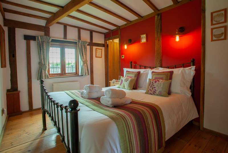 The beautiful beams add to the charm of this lovely ground floor bedroom.