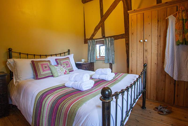 The ground floor bedroom is full of character with high sloping ceilings and gorgeous linens.