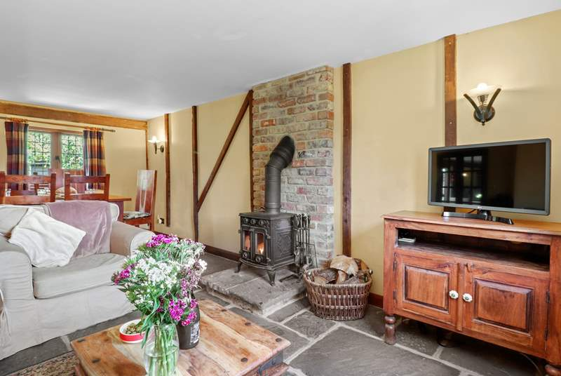 The open plan living-room with gorgeous stone floors and wood-burner.