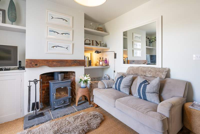 The beautifully decorated sitting-room, lie back and relax with the wood-burner crackling away in the background.