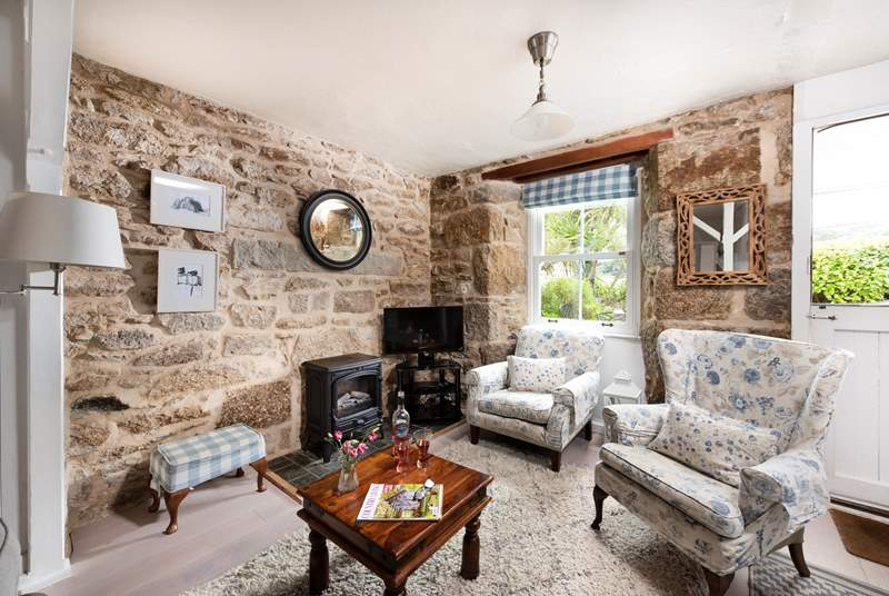 Beautifully furnished, the sitting-room invites you to relax and re-charge.