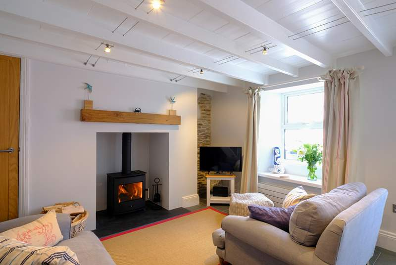 The super snug sitting-room with warming wood-burner to keep you warm in cooler months.