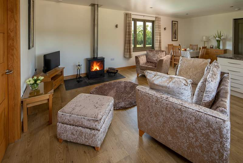 The cosy sitting area has this wonderful wood-burner. Perfect for those chillier evenings.