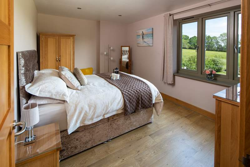 The main bedroom has fabulous countryside views and oodles of space.