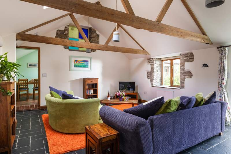 The beautiful rustic beams and stone walls make for a cosy living area.