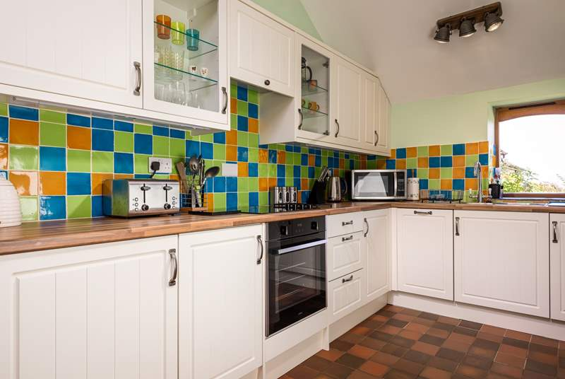 Cook up a feast in this well-equipped kitchen with a lovely view from the window.
