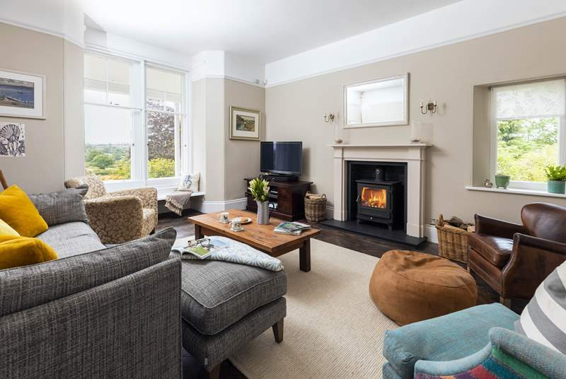 Cosy up in the sitting-room next to the wood-burning stove.