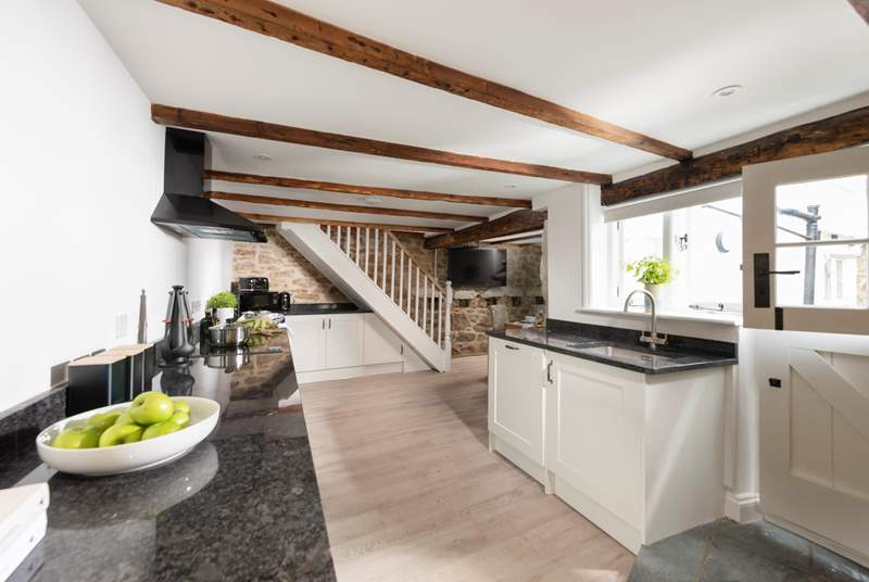 The sleek and contemporary kitchen/diner is well-equipped with everything you need to create those fabulous holiday breakfasts or lazy evening suppers.