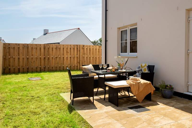 An enclosed sunny garden and terrace to enjoy outside dining.
