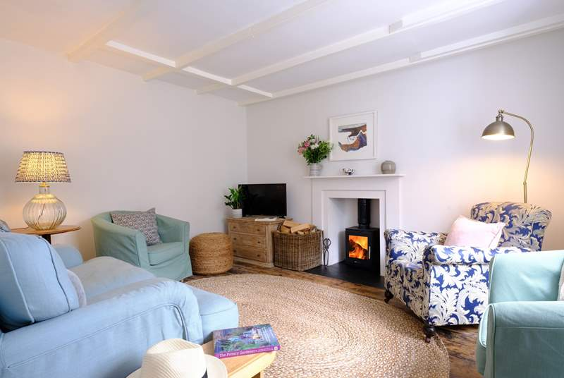 The pretty sitting-room invites you to relax, you are on holiday after all!
