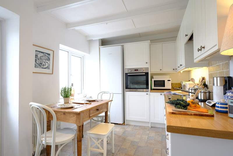 Natural light floods the well-equipped kitchen.