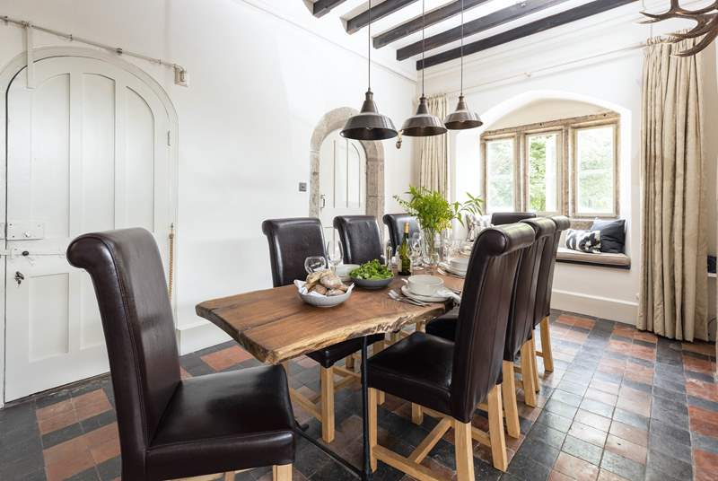 The elegant dining-area with feature oak table is the perfect place to gather the family and chat about the day ahead.