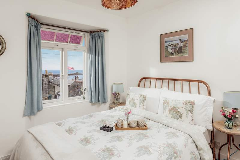 The very pretty main bedroom has a sea view.