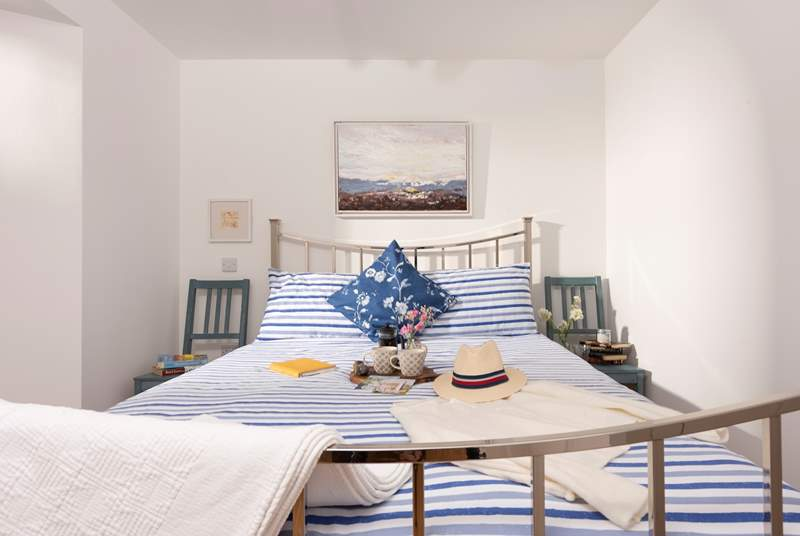 The main bedroom has a super-comfy king-size bed.